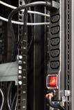 在服务器机架的黑人权力棒 库存照片