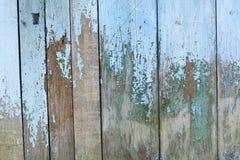 在木书桌上的老脏的油漆 库存照片