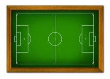 在木制框架的足球场。 免版税库存照片