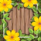 在木制框架的黄色花 皇族释放例证