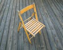 在木地板上的木椅子 免版税库存图片
