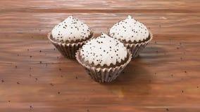 在木地板, 3d上的3巧克力杯形蛋糕现实被回报的杯形蛋糕 免版税库存照片