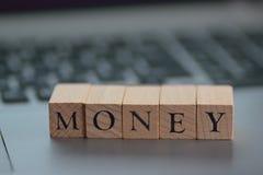 在木块写的例证财政期限 免版税图库摄影