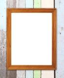 在木墙壁上的空白的木框架 库存照片