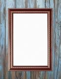 在木墙壁上的空白的木框架 免版税库存照片