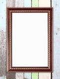 在木墙壁上的空白的木框架 免版税图库摄影