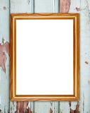 在木墙壁上的空白的木框架 图库摄影