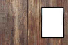 在木墙壁上的空白的海报照片框架 库存照片
