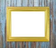 在木墙壁上的空白的金黄框架 图库摄影
