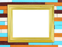 在木墙壁上的空白的金黄框架 库存图片