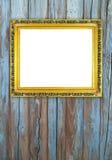 在木墙壁上的空白的金黄框架 免版税库存图片