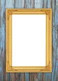 在木墙壁上的空白的金黄框架 免版税库存照片