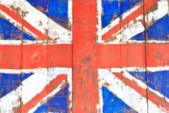 在木墙壁上的英国旗子 库存图片