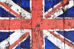 在木墙壁上的英国旗子 库存照片