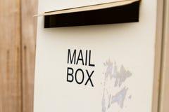 在木墙壁上的邮箱 免版税图库摄影