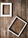 在木墙壁上的画框 免版税图库摄影