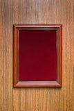 在木墙壁上的Photoframe 库存图片