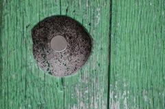 在木墙壁的一个孔 图库摄影