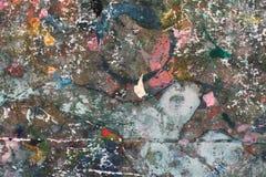 在木头的五颜六色的抽象油漆纹理 库存图片