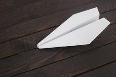 在木头的纸飞机 图库摄影