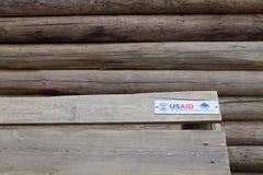 在木头的美国援助 免版税库存照片