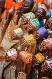 在木头雕刻的非洲小组妇女 免版税库存图片