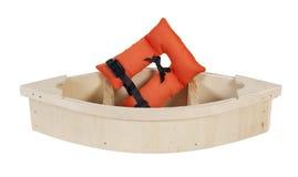 在木小船的救生背心 库存图片