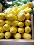 在木杂货店容器的黄南瓜 免版税图库摄影