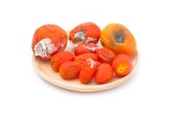 在木板材的腐烂的蕃茄 图库摄影