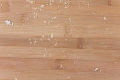 在木板的特写镜头宏观面包屑 库存图片