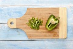 在木板的青椒在蓝色桌上 免版税图库摄影