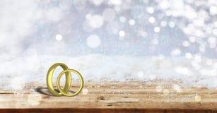 在木桌上的两个金婚圆环,弄脏多雪的背景,拷贝空间, 3d例证 库存例证