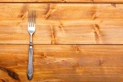 在木桌上的叉子 免版税库存照片