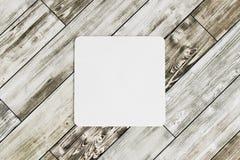 在木桌上的方形的沿海航船 免版税图库摄影