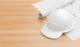 在木桌上的白色安全帽与图纸 工程师、监督员、经理和工头的安全帽 3d 免版税库存图片
