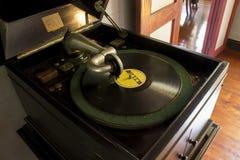 在木桌上的老转盘 免版税图库摄影