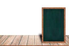 在木桌上的黑板木框架黑板标志菜单在与拷贝空间的白色背景放置 免版税库存照片