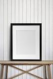 在木桌上的黑画框 免版税图库摄影