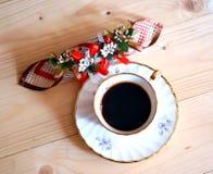 在木桌上的Coffe杯子 库存图片