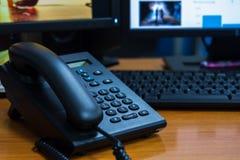 在木桌上的IP电话在办公室 免版税库存图片