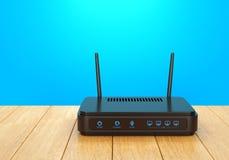 在木桌上的Wi-Fi路由器 图库摄影