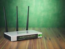 在木桌和绿色bac上的Wi-Fi无线互联网路由器 免版税库存图片