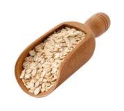 在木瓢的有机燕麦片 免版税库存照片