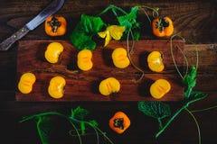 在木的柿子 免版税图库摄影
