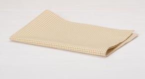 在木的白色的自然棉花餐巾被绘 库存图片