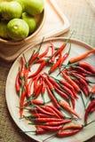 在木碗的新鲜的红辣椒在木背景 库存图片