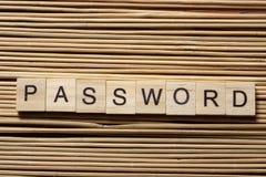 在木立方体的密码词在木背景 免版税库存图片