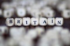 在木立方体的英国文本 库存照片