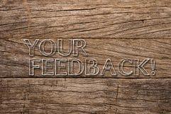 在木背景写的您的反馈 免版税库存图片
