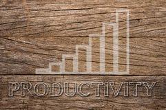 在木背景写的生产力提高 免版税库存图片